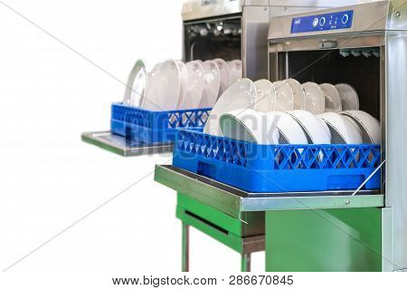 Close Up Cup And White Plate On Basket In Automatic Modern Dishwasher Machine For Industrial Isolate