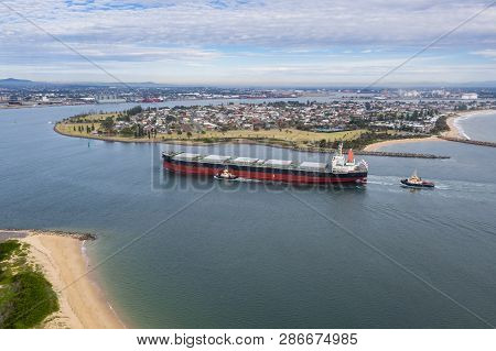 A Large Coal Transport Ship Entering Newcastle Harbour - Newcastle Is One Of The Largest Coal Export