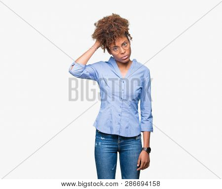 Beautiful young african american business woman over isolated background confuse and wonder about question. Uncertain with doubt, thinking with hand on head. Pensive concept.