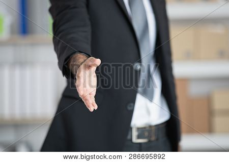 Portrait Of Young, Handsome, Asian, Businessman, Wearing Eyeglasses, In Business Suit, Posing Handsh