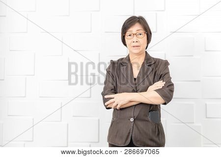 Portrait Of Asian Senior Businesswoman Working In Modern Home Office, Concept For Old People Doing B
