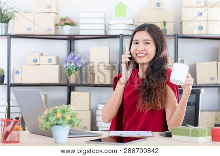 Shot Of Young Beautiful, Asian Business Lady Smiling With Dimples, Long Black Hair, In Styling Red D