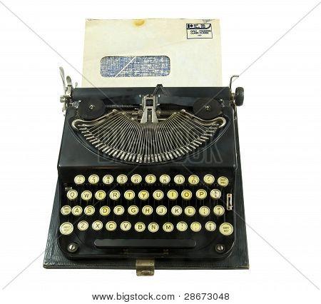 vintage typewriter with window envelope