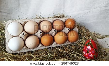 Packing Eggs With One Red Egg. Eggs For Easter. Painted Eggs. Red Egg Against White Eggs. Eggs In Th