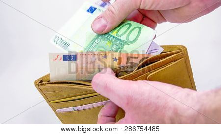 A Brown Wallet With 650 Euro Bills. The Bills Consisted With A 500 100 And 50 Euro Bills Then The Ma
