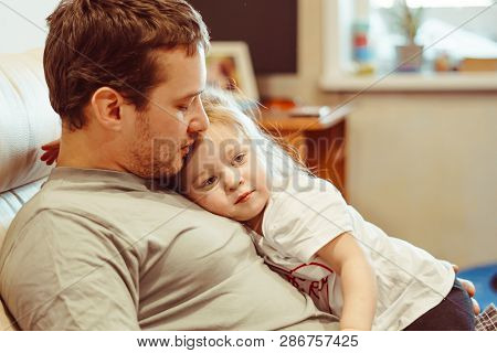 Father And Daughter Share Love In Their Arms