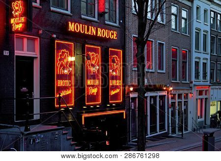 Amsterdam, Netherlands - March 26: Red Light District Called De Wallen On March 26, 2013 In Amsterda
