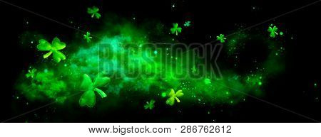 St. Patrick's Day abstract green background decorated with shamrock leaves. Patrick Day pub party celebrating. Abstract Border art design Magic backdrop. Widescreen clovers on black with copy space