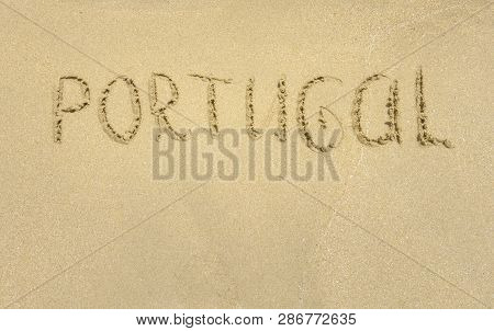 Inscription On Wet Sand Portugal. Cascais, Portugal