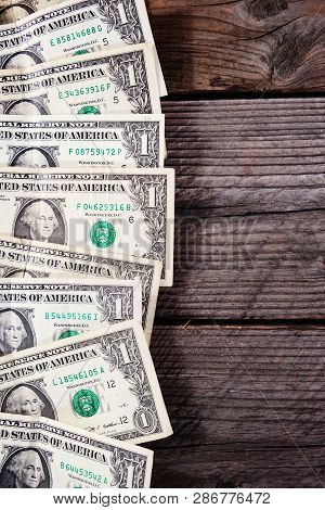 Frame Of One Dollar Bills On A Wood Background. View From Above.