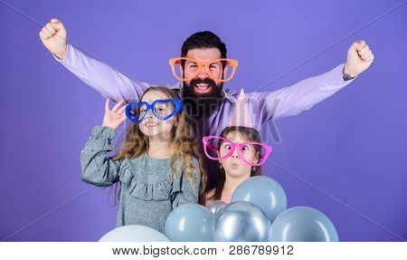 Fatherhood concept. Friendly family wear funny party accessories. Fathers day. Daughters need father actively interested in life. Single father. Birthday party. Father with two daughters having fun poster