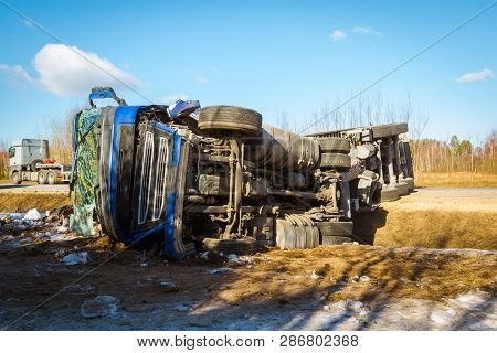 Car Accident On A Road In February 22, 2019, Cargo Vehicle Drove Off The Road And Turned Upside Down