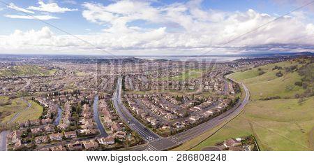 180 Degree aerial panorama of Folsom, California and Folsom Lake,