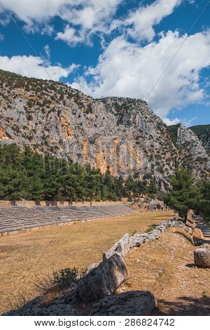Tourists Visit To The Stadium Of Delphi In The Highest Spot Of The Archaeological Site Of Delphi, Ce