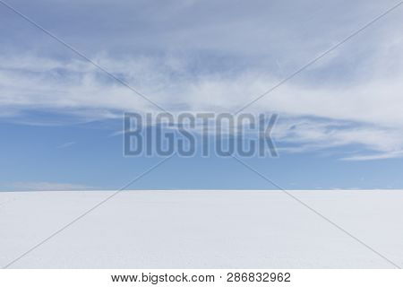 Blue Sky Over White Snowfield In Winter