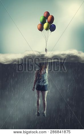 Woman Flying With Balloons Through A Rainy Cloud To The Sunny Sky. The Concept Of Overcoming Fears.