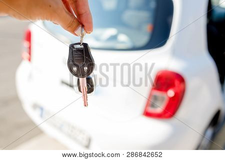 Woman Getting Her Key In The Car. Concept Of Rent Car Or Buying Car.travel Vacation With Rental Car.