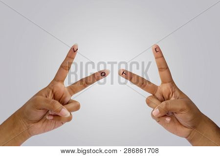 Two Hands Showing Vote With Symbol Of Victory Or Peace. Hand Raised For Vote In India. Background Co