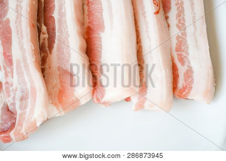 Close Up Freshness Cutting Slide Pork Belly Raw Or Streaky Pork. Pork Belly Is A Boneless Cut Of Fat