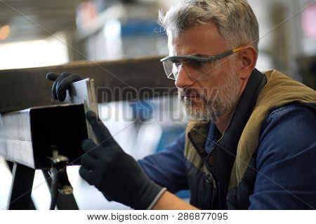 Mature ironworker in workshop