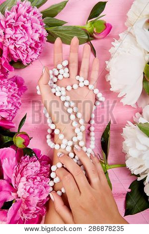 Hands Of Woman Florist Holding Beautiful Bouquet Of Peonies.