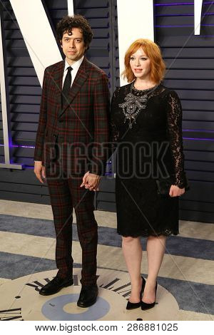 BEVERLY HILLS - FEB 24: Geoffrey Arend, Christina Hendricks at the 2019 Vanity Fair Oscar Party at The Wallis Annenberg Center for the Performing Arts on February 24, 2019 in Beverly Hills, CA