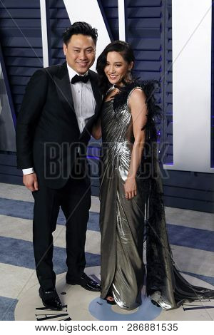 BEVERLY HILLS - FEB 24: Jon M Chu, Constance Wu at the 2019 Vanity Fair Oscar Party at The Wallis Annenberg Center for the Performing Arts on February 24, 2019 in Beverly Hills, CA