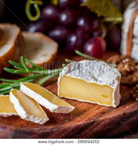 Sliced Hard French Cheese With Bread, Grapes, Herbs And Nuts, Square
