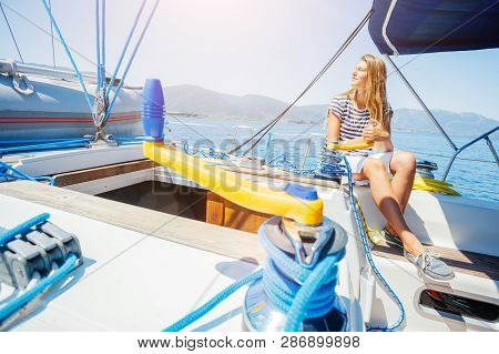 Girl On Board Of Sailing Yacht On Summer Cruise. Travel Adventure, Yachting With Child On Family Vac