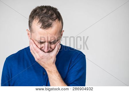 Depressed, Sad, Worried Adult Man Covering His Mouth Feeling Guilt And Shame.
