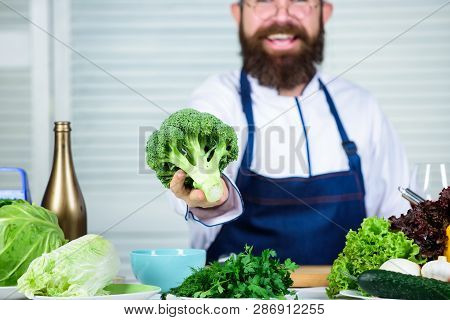 Organic Vegetables. I Choose Only Healthy Ingredients. Man Cook Hat And Apron Hold Broccoli. Healthy