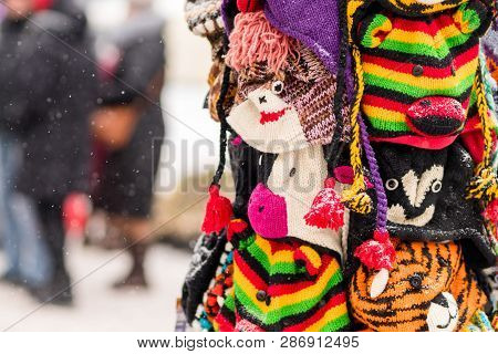 Winter Hats On Display On A Snowy Day In Holiday City Fare. Chri