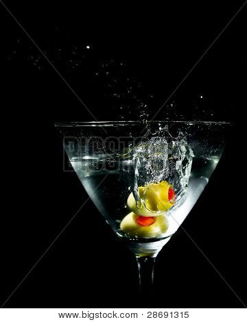 Two Olives Splashing Into Martini Glass