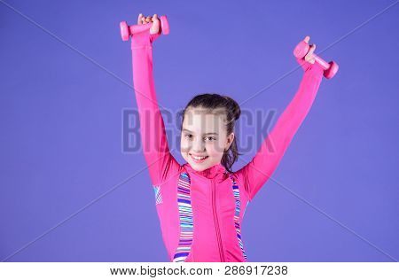 Strong And Adorable. Small Baby Developing Strength With Dumbells. Fit Kid Exercising Her Strength.