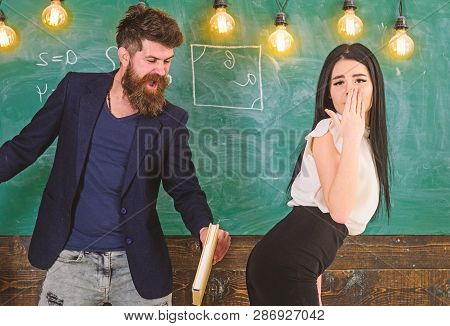 Girl on helpless face punished by teacher. Schoolmaster punishes sexy student with slapping on her buttocks with book. Man with beard slapping sexy student, chalkboard on background. Role game concep poster