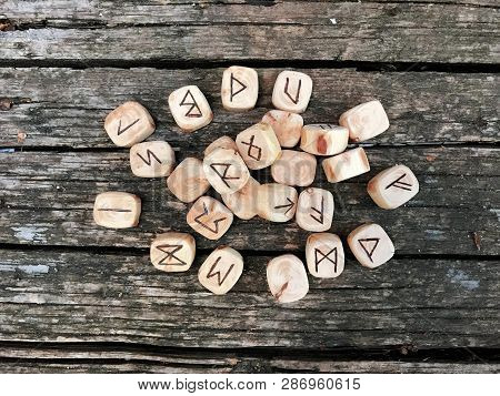 A Stack Of Wooden Runes At Forest. Wooden Runes Lie On A Old Wood Background. Runes Are Cut From Woo