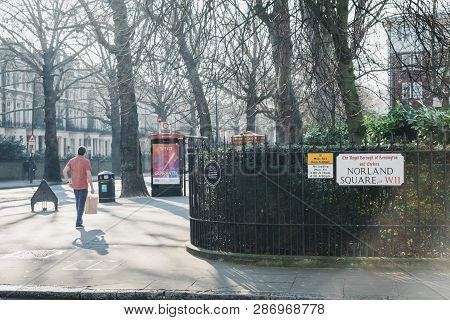 London, Uk - February 23, 2019: Man Walking On A Street In Holland Park, The Royal Borough Of Kensin