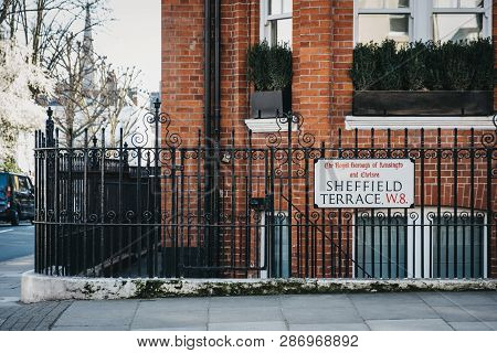 London, Uk - February 23, 2019: Sheffield Terrace Street Name Sign On A Black Fence In The Royal Bor