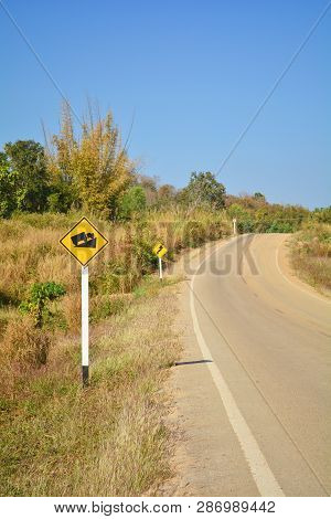 Warning Road Sign Uphill And Road Curve - Steep Grade Hill Traffic Sign