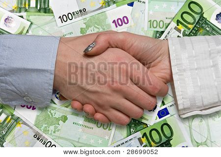 Eurozone deal concept. business handshake on euros background poster