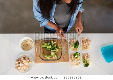 Overhead View Of Woman In Kitchen Preparing High Protein Meal