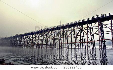 Mon Wood Bridge In The Morning In The Fog Down (sangkhla Buri, Kanchanaburi, Thailand) This Mon Wood