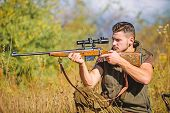 Hunting weapon gun or rifle. Hunting target. Looking at target through sniper scope. Man hunter aiming rifle nature background. Hunting skills and weapon equipment. Guy hunting nature environment poster