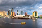 Tampa, Florida, USA downtown skyline on the bay at dusk with water traffic. poster