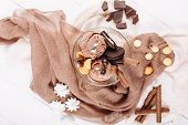 Chocolate Icecream Cookie Dessert Bowl Flat Lay. Cold Delicious Brown Ice Cream Ball and Biscuit on Textile Background Top Down View. Cocoa Gelato Serving Closeup Horizontal Copy Space Banner poster