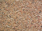 Wall texture with small brown pebble stone poster
