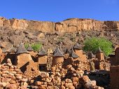 The Dogon people build large cities of mud on the side of mouontains in the Bondiagara Escarpment of Mali, in West Africa. poster