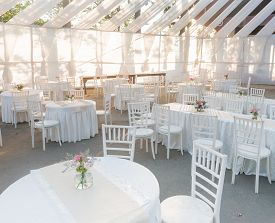 An Outdoor Venue For A White Wedding, On A Bright Sunny Day