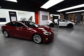 Tesla Deep Red Model S 100d And White Model X P100d All Electric Cars On Display At A Tesla Car Deal
