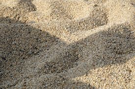 Sand Surface Background On The Beach. Small Sand Stone Of Sand Wall Texture Or Sand Wall Background